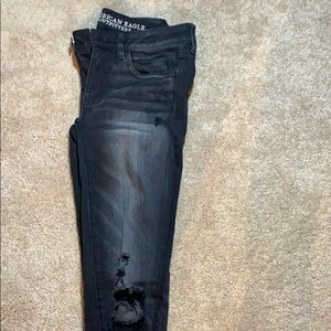 Black, ripped American eagle slim fit jeans.